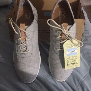 Toms tennis shoes, new, size 12 Women's